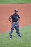 Umpire A.J. Johnson handles the calls on the bases during the Pacific Coast League game between the Salt Lake Bees and the Albuquerque Isotopes at Smith's Ballpark on June 27, 2015 in Salt Lake City, Utah. The Bees defeated the Isotopes 8-6. (Stephen Smith/Four Seam Images)