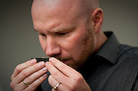 Norwegian employees of the European company StatOil, Thomas Johansen (cq, 32, right), a completion engineer from Matrand, smells a shale ore sample for hints of gas at Chesapeake Energy's headquarters in Oklahoma City, OK, Thursday, Sept., 23, 2009. Chesapeake Energy has a new program to work with foreign companies to help train on new shale technology....PHOTOS/ MATT NAGER