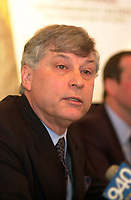 Montreal, April 3rd 2001<br /> Peter Trent, Mayor of Westmount spokesman for The Coalition of Citizens and Munucipalities Chalenging Bill 170 ; a group of citizen opposed to the forced municipal mergers of  Montreal island cities, ; presented today  April 3rd 2001 at a press conference in Montreal, a KPMG special experts' report that revealed that only half of the alleged 50 000 people signed the Mayor of Montreal Pierre Bourque's ``We,re all Montrealers`` petition presented to Quebec Minister of Municipal Affairs Louise Harel to convince her to force by law the merger of all cities on Montreal island.<br /> <br /> The coalition position is that Montreal should not repeat Toronto mistake by forcing all cities to merge together.<br /> Photo by Pierre Roussel / I Photo<br /> NOTE :  D-1 photo uncorrected