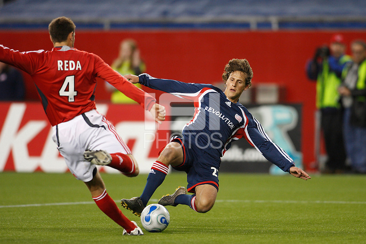 Toronto FC defender (4) Marco Reda and New England Revolution midfielder (27) Wells Thompson go for he ball late in the second half. The New England Revolution defeated Toronto FC 4-0 at Gillette Stadium, Foxbourgh, MA, on April 14, 2007.