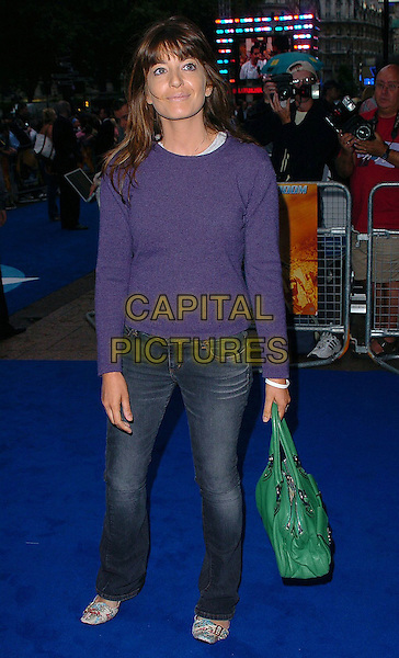 """CLAUDIA WINKLEMAN.At the UK Film Premiere of """"Fantastic Four"""",.Vue Cinema, Leicester Square, .London, July 18th 2005..full length green bag jeans jumper .Ref: CAN.www.capitalpictures.com.sales@capitalpictures.com.©Can Nguyen/Capital Pictures."""