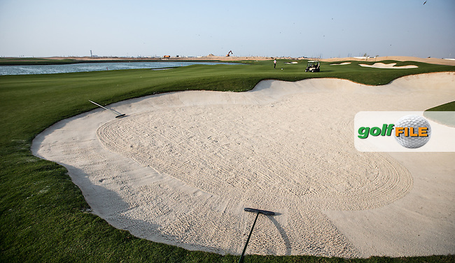 View of the right-side fairway bunker on the 16th at Al Zorah Golf Club, Dubai, United Arab Emirates.  26/01/2016. Picture: Golffile | David Lloyd<br /> <br /> All photos usage must carry mandatory copyright credit (&copy; Golffile | David Lloyd)