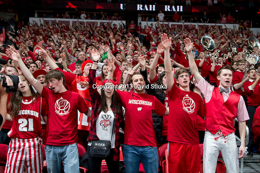 "Wisconsin Badger fans sing ""Varsity"" during a Big Ten Conference NCAA college basketball game against the Michigan Wolverines Saturday, February 9, 2013, in Madison, Wis. The Badgers won 65-62 (OT) (Photo by David Stluka)"