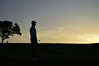 HaoTong Li (CHN) is silhouetted by the early Friday morning sunrise as he watches his approach shot on 10 during day 2 of the Valero Texas Open, at the TPC San Antonio Oaks Course, San Antonio, Texas, USA. 4/5/2019.<br /> Picture: Golffile | Ken Murray<br /> <br /> <br /> All photo usage must carry mandatory copyright credit (&copy; Golffile | Ken Murray)