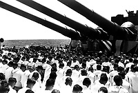 The crew of the USS SOUTH DAKOTA stands with bowed heads, while Chaplain N.D. Lindner reads the benediction held in honor of fellow shipmates killed in the air action of Guam on June 19, 1944.  (Navy)<br /> NARA FILE #:  026-G-4677<br /> WAR &amp; CONFLICT BOOK #:  929