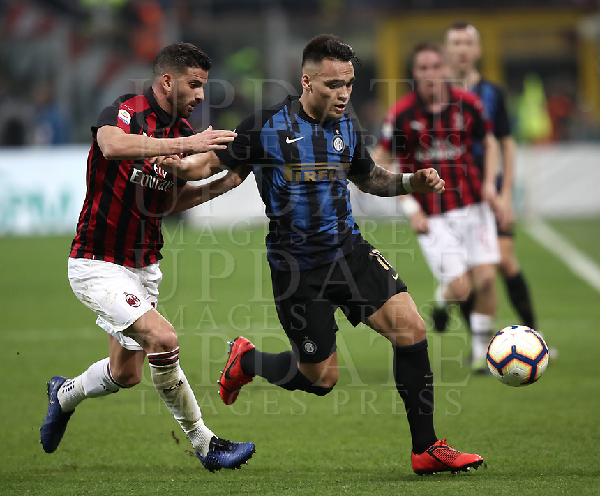 Calcio, Serie A: AC Milan - Inter Milan, Giuseppe Meazza (San Siro) stadium, Milan on 17 March 2019.  <br /> Inter's Lautaro Martinez (r) in action with Milan's Mateo Musacchio (l) during the Italian Serie A football match between Milan and Inter Milan at Giuseppe Meazza stadium, on 17 March 2019. <br /> UPDATE IMAGES PRESS/Isabella Bonotto