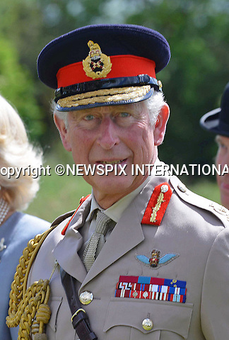 05.06.2014; Normandy, FRANCE: PRINCE CHARLES AND CAMILLA,DUCHESS OF CORNWALL<br /> visited Pegasus Bridge where the D-Day landings started, 70 years ago, to lay a wreath at the Glider Pilot Memorial before meeting veterans.<br /> The Prince of Wales is the Colonel in Chief of Army Air Corps,<br /> Mandatory Credit Photo: &copy;Reddy-Crown Copyright/NEWSPIX INTERNATIONAL<br /> <br /> **ALL FEES PAYABLE TO: &quot;NEWSPIX INTERNATIONAL&quot;**<br /> <br /> IMMEDIATE CONFIRMATION OF USAGE REQUIRED:<br /> Newspix International, 31 Chinnery Hill, Bishop's Stortford, ENGLAND CM23 3PS<br /> Tel:+441279 324672  ; Fax: +441279656877<br /> Mobile:  07775681153<br /> e-mail: info@newspixinternational.co.uk