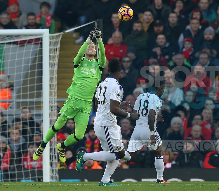Loris Karius of Liverpool punches clear under pressure from Jermain Defoe of Sunderland during the Premier League match at the Anfield Stadium, Liverpool. Picture date: November 26th, 2016. Pic Simon Bellis/Sportimage