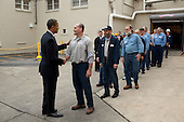 Allentown, PA - December 4, 2009 -- United States President Barack Obama greets workers during a shift change at the Nestlé Purina PetCare facility in Allentown, Pennsylvania, Friday, December 4, 2009.  .Mandatory Credit: Pete Souza - White House via CNP