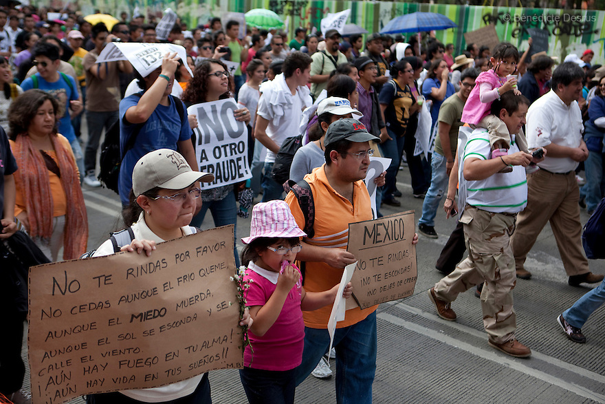 7 July 2012 - Mexico City, Mexico - Tens of thousands of protesters march through Mexico's capital against President-elect Enrique Pena Nieto, accusing his party of buying votes and paying off TV networks to help him win the country's presidential vote. Pena Nieto, who says the vote was clean and fair, won July 1 national elections by almost 7 percentage points, according to the official count. The demonstrators, including students, leftists, anarchists and union members,  shouted slogans criticizing Pena Nieto's Institutional Revolutionary Party (PRI), and the electoral authority. Photo credit: Benedicte Desrus