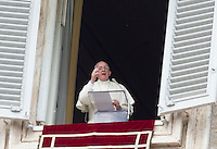 Papa Francesco celebra l'Angelus dalla finestra del suo studio su Piazza San Pietro, Citta' del Vaticano, 12 ottobre 2014.<br /> Pope Francis celebrates the Sunday Angelus noon prayer from his studio window overlooking St. Peter's Square at the Vatican, 12 October 2014.<br /> UPDATE IMAGES PRESS/Riccardo De Luca<br /> <br /> STRICTLY ONLY FOR EDITORIAL USE