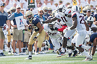 Annapolis, MD - SEPT 10, 2016: Navy Midshipmen running back Dishan Romine (28) breaks free of a tackle by Connecticut Huskies safety Obi Melifonwu (20) and Connecticut Huskies linebacker Junior Joseph (11) during their match up at Navy-Marine Corps Memorial Stadium in Annapolis, MD. Navy held on to defeat Connecticut 28-24. (Photo by Phil Peters/Media Images International)