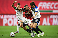 Rafael Toloi of Atalanta BC , Ante Rebic of AC Milan and Remo Freuler of Atalanta BC compete for the ball during the Serie A football match between AC Milan and Atalanta BC at stadio Giuseppe Meazza in Milano ( Italy ), July 24th, 2020. Play resumes behind closed doors following the outbreak of the coronavirus disease. <br /> Photo Image Sport / Insidefoto