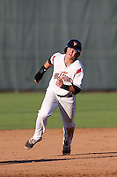 Christian Arroyo #15 of the Salem-Keizer Volcanoes runs the bases during a game against the Eugene Emeralds at Volcanoes Stadium on July 27, 2014 in Keizer, Oregon. Salem-Keizer defeated Eugene, 9-1. (Larry Goren/Four Seam Images)