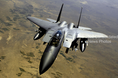 Over Afghanistan - November 8, 2008 -- A U.S. Air Force F-15E Strike Eagle aircraft returns to the fight after receiving fuel Wednesday, May 28, 2008 from a KC-135R Stratotanker during a mission over Afghanistan. F-15E is deployed from Royal Air Force Lakenheath England and the KC-135R is assigned to the 22nd Expeditionary Air Refueling Squadron, 376th Air Expeditionary Wing and is deployed from Fairchild Air Force Base Washington. .Credit: Andy Dunaway - U.S. Air Force via CNP.