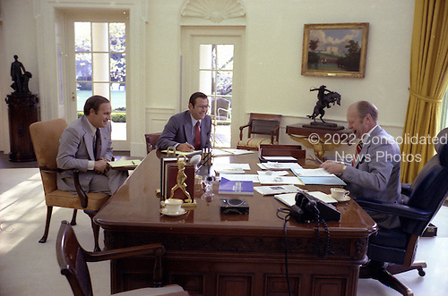 United States President Gerald R. Ford Ford meets with Chief of Staff Donald Rumsfeld and Dick Cheney in the Oval Office of the White House in Washington, DC on April 22, 1975.<br /> Mandatory Credit: David Hume Kennerly / White House via CNP