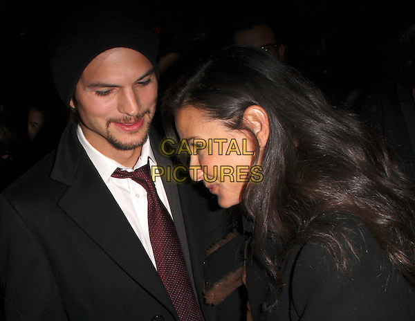 "ASHTON KUTCHER & DEMI MOORE.""Spread"" After Party held at The Village Lift, Park City, Utah, USA..January 17th, 2009.headshot portrait black hat goatee facial hair profile married husband wife .CAP/ADM/KB.©Kevan Brooks/AdMedia/Capital Pictures."