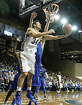 SIOUX FALLS, SD - NOVEMBER 30:  Cody Larson #34 from South Dakota State University scoops a shot around Nate Hicks #1 from Florida Gulf Coast in the first half of their game Sunday afternoon at the Sanford Pentagon in Sioux Falls. (Photo by Dave Eggen/inertia)