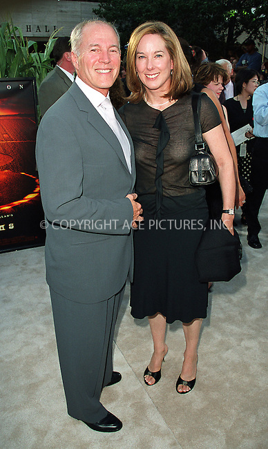"Executive producer Kathleen Kennedy & producer Frank Marshall arrive at the world premiere of Touchstone Pictures' movie, ""Signs"" at Lincoln Center, New York. July 29, 2002. Please byline: Alecsey Boldeskul/NY Photo Press.   ..*PAY-PER-USE*      ....NY Photo Press:  ..phone (646) 267-6913;   ..e-mail: info@nyphotopress.com"