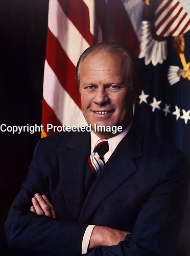 Ford, arms folded, in front of a United States flag and the Presidential seal. 27 August 1974.<br /> <br /> PHOTO : David Hume Kennerly