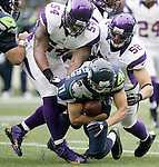 Minnesota Vikings defenders Jasper Brinkley (54) and Chad Greenway team up to bring down Seattle Seahawks wide receiver Jermaine Kearse at CenturyLink Field in Seattle, Washington on  November 4, 2012.  The Seahawks beat the Vikings 30-20.    ©2012. Jim Bryant Photo. All Rights Reserved.