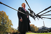 United States President Donald J. Trump talks to reporters before boarding Marine One on the South Lawn of the White House on November 4, 2018 in Washington, DC. <br /> CAP/MPI/RS<br /> &copy;RS/MPI/Capital Pictures