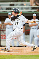 Tyler White #28 of the Gastonia Grizzlies follows through on his swing against the Thomasville HiToms at Sims Legion Park on June 2, 2011 in Gastonia, North Carolina.  The Hi-Toms defeated the Grizzlies 9-4.  Photo by Brian Westerholt / Four Seam Images