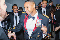 US Army Lt. Colonel Myles B. Caggins III, Director for Strategic Communications and Assistant Press Secretary for the National Security Council, dances at the MSNBC After Party at the United States Institute of Peace in Washington, DC. The party followed the annual White House Correspondents Association Dinner on Saturday, April 30, 2016. The party continued until about 3 AM on Sunday, May 1, 2016.