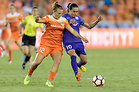 Houston, TX - Saturday June 17, 2017: Amber Brooks and Marta Vieira Da Silva battle for control of the ball  during a regular season National Women's Soccer League (NWSL) match between the Houston Dash and the Orlando Pride at BBVA Compass Stadium.