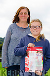 TIDY TOWN HERO: Pictured at her school in Caher, Kenmare with her teacher Michelle O'Connell is young Lucy Daly clutching her Hero's Certificate from the 2015 Tidy Towns Awards.