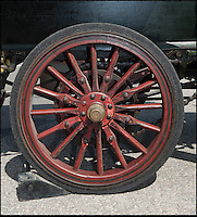 BNPS.co.uk (01202 558833)<br /> Pic: PhilYeomans/BNPS<br /> <br /> Cart wheels.<br /> <br /> Staff at the Haynes motor museum have dusted off what is thought to be Britains first wedding car, after the remarkable discovery in New Zealand of a 110 year old wedding snap.<br /> <br /> The museum's research has unearthed the Edwardian photograph of the old Daimler at the 1903 wedding between a Mr James Andrews and Miss Rosa Gough in Weston-Super-Mare - thought to be the first time a car was used for as wedding transport in Britain.<br /> <br /> The 1897 British built Daimler Wagonette dates from the very earliest days of motoring when the phrase 'Horseless carriage' was very apt. Its rudimentary 2 cylinder petrol engine only produced 6.5hp giving a top speed of only 11.6mph. <br /> <br /> The car featured cart wheels with solid tyres, a metal rod that functioned as a 'hand' brake, leather mud flaps and cart springs...and the brakes were rubber blocks that gripped the tyres.