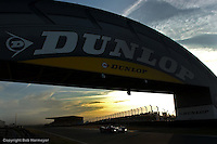 LE MANS, FRANCE: The Knight Hawk Racing MG Lola EX257 004/AER of Mel Hawkins, Steven Knight and Duncan Dayton is driven under the Dunlop Bridge during practice for the 24 Hours of Le Mans on June 16, 2002, at Circuit de la Sarthe in Le Mans, France.