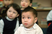 Children listen to a story at a Chinese nursery in Camden Town, London.