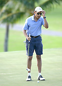 United States President Barack Obama checks his shot on the 18th hole as he and friends Marvin Nicholson, Bobby Titcomb, and Eric Whitaker enjoy a round of golf at Mid Pacific Country Club, Kailua, Hawaii on Monday, December 23, 2013.  The first family is enjoying holiday vacation in Hawaii until January 5, 2014. <br /> Credit: Cory Lum / Pool via CNP