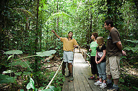 Indigenous guide and family on tour of rainforest at Daintree Eco Lodge and Spa.  The region bounded by Cooktown in the north and Port Douglas in the south is the traditional home of the indigenous Kuku Yalanji people.  Daintree, Queensland, Australia