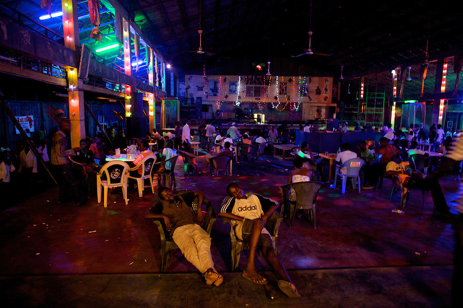 frequenters of the Shrine, a famous nightclub home of Fela Kuti's son Femi, sit exhousted on chairs in Nigeria's capital Lagos on Monday March 30 2009..The club was home to the king of Afrobeat, Fela Anikulapo Kuti, who died in 1997 from Aids-related reasons..For more than two decades Fela performed at the shrine with the same incredible energy with which he enjoyed drugs and women..The shrine - then a dingy club on the outskirts of Lagos that became a legend - closed soon after Fela's death.