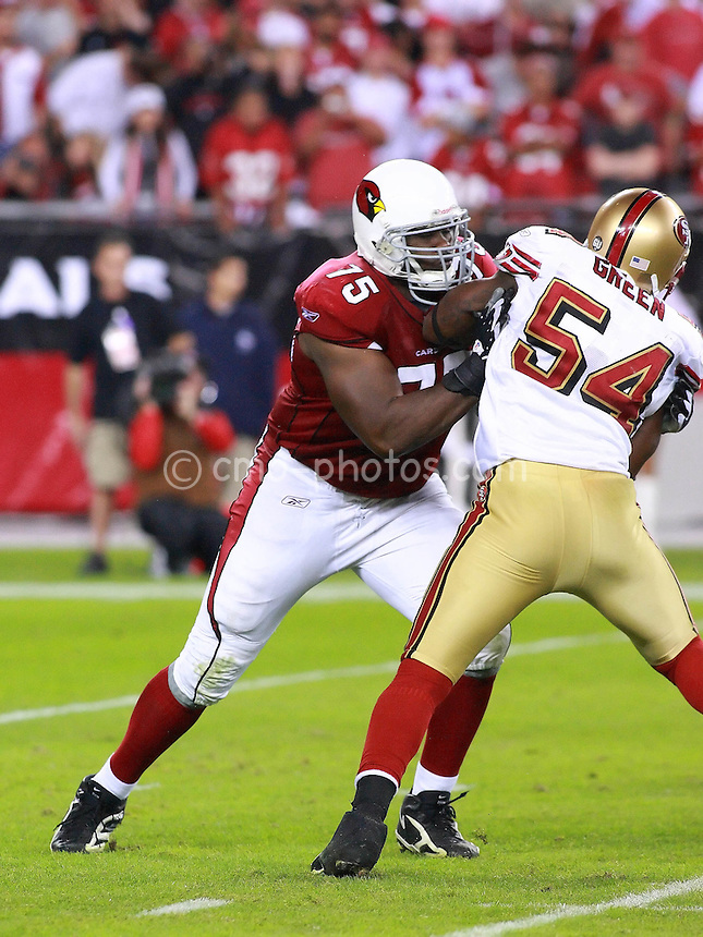Nov 10, 2008; Glendale, AZ, USA; Arizona Cardinals offensive tackle Levi Brown (75) blocks San Francisco 49ers linebacker Roderick Green (54) in the fourth quarter of a Monday Night Football game at University of Phoenix Stadium.  The Cardinals won the game 29-24.