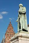 Statue of Gutenberg (1837) by Bertel Thorvaldsen (1770-1844) in Mainz, Rheinland-Pfalz, Germany (Johannes Gensfleisch zur Laden zum Gutenberg,  c. 1400 - 3.2.1468) [the suitcase is not part of the artist's work], in the background Saint Martin Dome<br /> <br /> Monumento a Gutenberg (1837) por Bertel Thorvaldsen (1770-1844) en Maguncia, Rheinland-Pfalz, Alemania (Johannes Gensfleisch zur Laden zum Gutenberg, ca. 1400 - 3.2.1468) [la maleta no es parte de la obra del artista], en el fondo Catedral de San Mart&iacute;n<br /> <br /> Gutenberg-Denkmal (1837) von Bertel Thorvaldsen (1770-1844) in Mainz, Rheinland-Pfalz, Deutschland (Johannes Gensfleisch zur Laden zum Gutenberg, ca. 1400 - 3.2.1468) [der Koffer ist nicht Teil des Kunstwerks], im Hintergrund St. Martin Dom<br /> <br /> 3008 x 2000 px<br /> 150 dpi: 50,94 x 33,87 cm<br /> 300 dpi: 25,47 x 16,93 cm