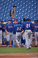 AZL Rangers Keyber Rodriguez (22) is congratulated by teammates after hitting a home run during an Arizona League game against the AZL Brewers Blue on July 11, 2019 at American Family Fields of Phoenix in Phoenix, Arizona. The AZL Rangers defeated the AZL Brewers Blue 5-2. (Zachary Lucy/Four Seam Images)