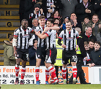 Celebrations as Calum Dyson (2nd left) of Grimsby Town scores to make it 1 0 during the Sky Bet League 2 match between Grimsby Town and Wycombe Wanderers at Blundell Park, Cleethorpes, England on 4 March 2017. Photo by Andy Rowland / PRiME Media Images.