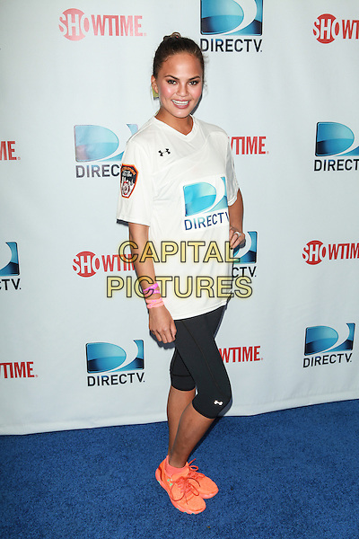 NEW YORK, NY - FEBRUARY 1: Chrissy Teigen attends the DirecTV Beach Bowl at Pier 40 on February 1, 2014 in New York City. <br /> CAP/MPI/COR<br /> &copy;Corredor99/ MediaPunch/Capital Pictures
