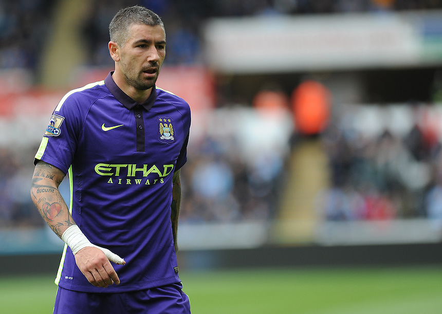 Manchester City's Aleksandar Kolarov in action during todays match  <br /> <br /> Photographer Ashley Crowden/CameraSport<br /> <br /> Football - Barclays Premiership - Swansea City v Manchester City - Sunday 17th May 2015 - Liberty Stadium - Swansea<br /> <br /> &copy; CameraSport - 43 Linden Ave. Countesthorpe. Leicester. England. LE8 5PG - Tel: +44 (0) 116 277 4147 - admin@camerasport.com - www.camerasport.com