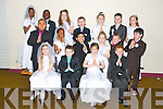 Pupils of Karen O'Connor's class, Moyderwell primary school who have made their First holy Communion, pictured on Tuesday. Pictured in the back row are: Debbie Oluwadare, Nelly Olanrewaju, Jessica OShea, Adam Maher, Sophie Reidy, Daniel Moriarty and Paula Rogers. Middle row: Tobi Agboola, Favor Itsede, Christian Ycasas, Alisa Must, Jesse Duggan and Allan Wall Griffin. Front row: Grace Foley, David Hughes, April OConnor and Darragh OSullivan.