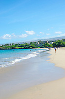 People walking and swimming at Hapuna Beach, along the Big Island's Kohala Coast. This white sand beach has been rated one of the best beaches in the world. Hawaii Prince Resort is at the north end of the beach.