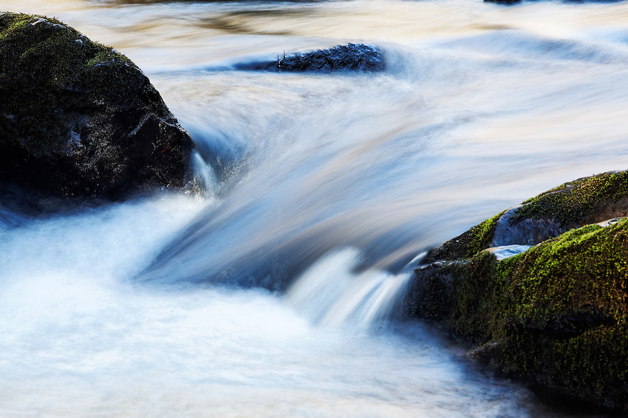 Cold water pours between two mossy boulders, Little Stony Creek, Pembroke, Giles County, Virginia, USA.