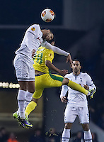 12.12.2013 London, England. Tottenham Hotspur midfielder Etienne Capoue (15) in an aerial battle with Anzhi Makhachkala forward Serder Serderov (28) during the Europa League game between Tottenham Hotspur and Anzhi Makhachkala from White Hart Lane.