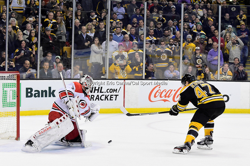 Tuesday, April 5, 2016: /Boston Bruins defenseman Torey Krug (47) shots against Carolina Hurricanes goalie Cam Ward (30) in a shoot out during the National Hockey League game between the Carolina Hurricanes and the Boston Bruins held at TD Garden, in Boston, Massachusetts. Carolina beats Boston 2-1 in an overtime shoot out.  Eric Canha/CSM