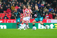 Joe Allen of Stoke City vies for possession with George Byers of Swansea City during the Sky Bet Championship match between Stoke City and Swansea City at the Bet 365 Stadium in Stoke-on-Trent, England, UK. Saturday 25 January 2020