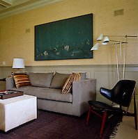 Bespoke furniture by Shamir Shah beneath a painting by Michael Redaecker in the study is joined by a vintage Danish chair and a lamp by David Weeks