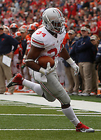 Ohio State Buckeyes running back Carlos Hyde (34) runs for a touchdown in the second quarter during Saturday's NCAA Division I football game against Illinois at Memorial Stadium in Champaign, Il., on November 16, 2013. Ohio State led at halftime with a score of 35-14. (Barbara J. Perenic/The Columbus Dispatch)